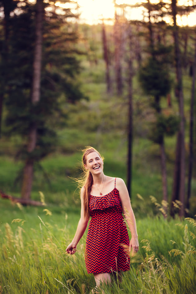 Kristine Paulsen Photography laughing and smiling in a field of grass